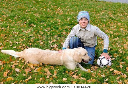 Boy Playing In Autumn Park