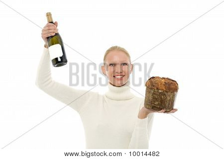 portrait of a young caucasian woman wearing a white turtleneck sweater and holding a panettone and a