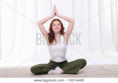 Young Girl Doing Yoga Exercises