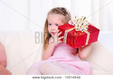 Little Girl Give A Holiday Gift