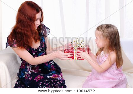 Little Girl Mom Gives A Holiday Gift