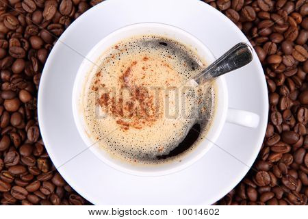 Coffee on coffee beans background