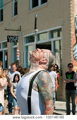 Man Carefully Swallows Sword In Atlanta Street Freak Show
