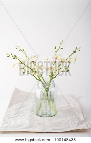Simple White Orchids In A Vintage Glass Jar With Space For Text