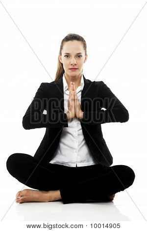 Young businesswoman doing yoga on white background studio