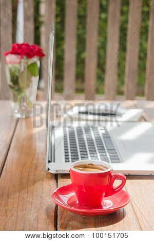 Hot Coffee Cup On Wooden Work Station