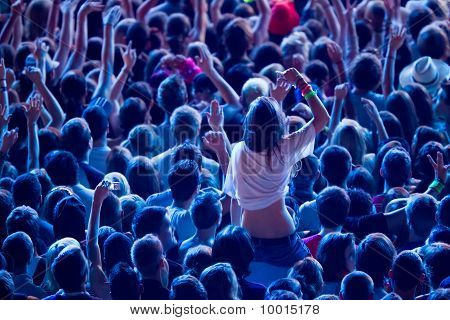 Girl Cheering With Crowd