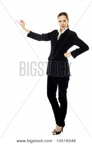 Young businesswoman holding a post-it on white background studio