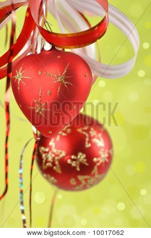Christmas Balls On A Green Background And Abstract Bokeh With  Space.