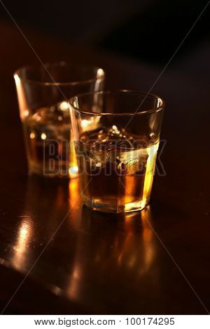 Whiskey glass tumbler standing on bar counter  poster