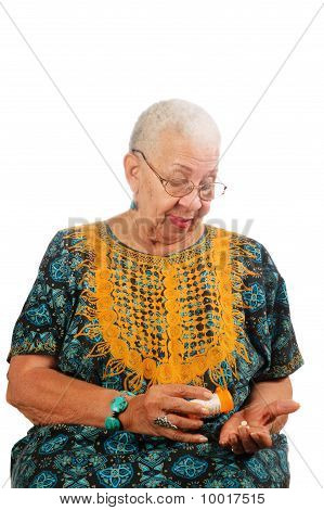 Elderly Woman Taking Pills