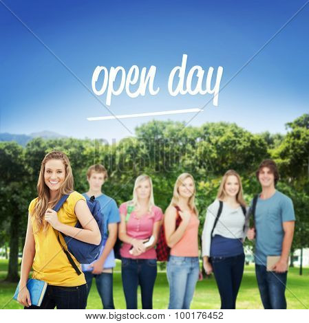 The word open day and a woman standing in front of his friends as she smiles against park
