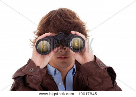 Young Man Looking Through Binoculars, With Symbol Of Money, Isolated On White, Studio Shot