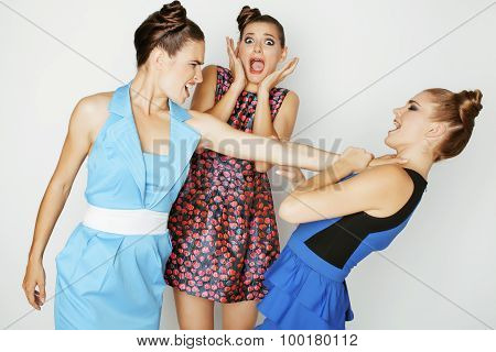 three elegant fashion woman fighting on white background