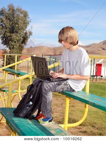 Teen Boy  Working On Laptop