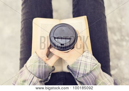 Hipster With A Book And Coffee Mug Outdoor