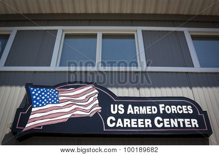 NEWTON, NJ-JUL 2015: The Armed Forces Career Center sign with the American Flag on it hangs on the side of the military recruitment station for the Army, Navy, and Air Force in Newton, NJ.
