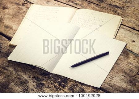 School Notebook With Pen On Old Wooden Table