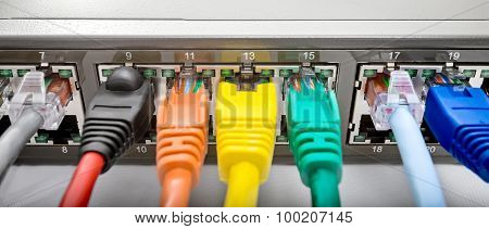 Network ethernet switch with connected colorful cables poster
