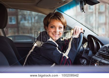Smiling woman sitting in new car