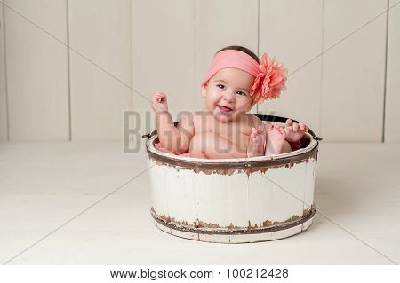Laughing Baby Girl In Wooden Bucket