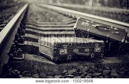 Not The Color Image Of Two Suitcases On Rails.