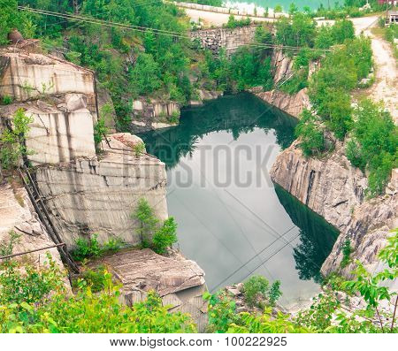 reflections into old granite quarry