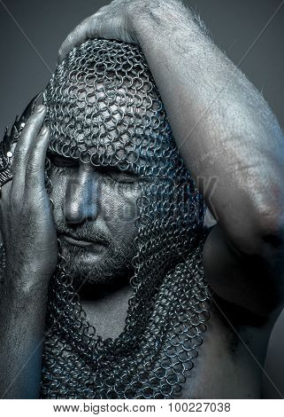Fantasy, medieval executioner mesh iron rings on the head