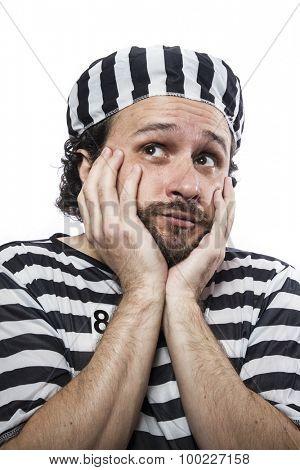 Outlaw, Desperate, portrait of a man prisoner in prison garb, over white background