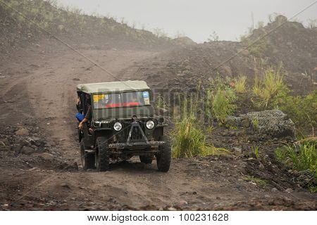 Mount Merapi , Java Indonesia - 15 April 2015 : Jeeps with tourists coming back from a ride around Merapi volcano.