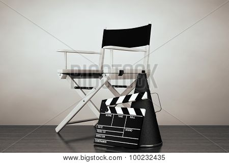 Old Style Photo. Director Chair, Movie Clapper And Megaphone