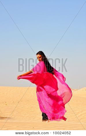 Beautiful Young Woman  Dancing In Arabic Desert