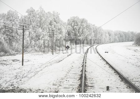 amazing winter landscape of snowy trees along a railway