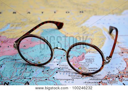 Glasses on a map of Asia - Pyongyang