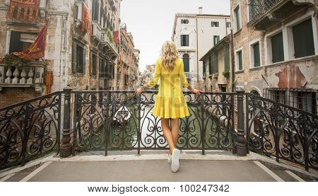 Woman standing on the bridge in Venice