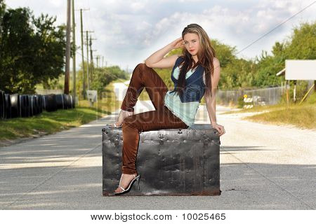Teen Girl on a Trunk in the Street (2)