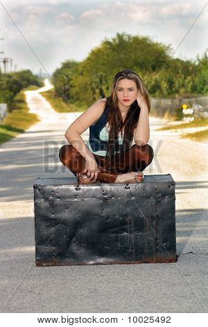 Teen Girl on a Trunk in the Street (3)