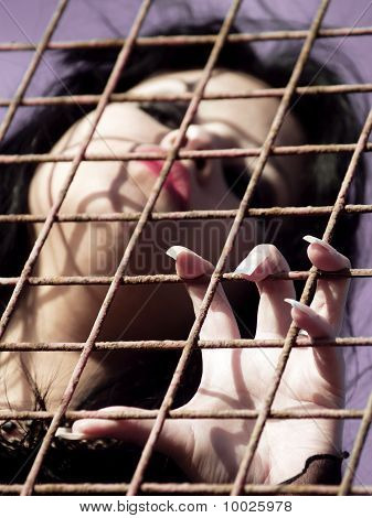 Long Nailed Woman In Jail