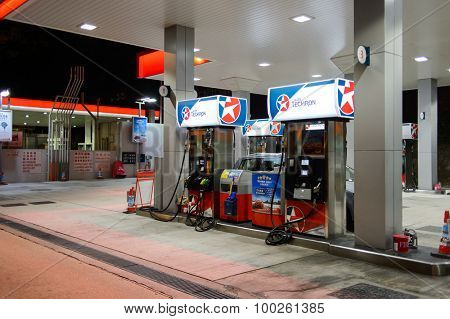 HONG KONG - APRIL 15, 2015: Caltex fuel station at evening. Caltex is a petroleum brand name of Chevron Corporation used in more than 60 countries