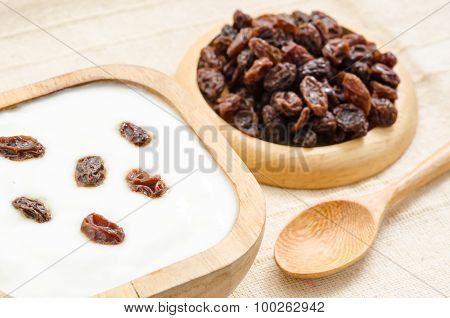 Home Sweet Yogurt With Raisins In A Wooden Bowl.