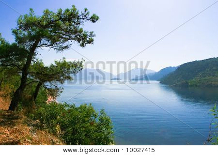 View of the bay. Icmeler. Beach, the mountains and the blue bay. Turkey
