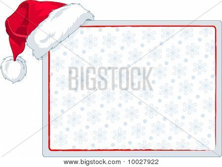 Santa's Cap Hanging On A Blank Place Card