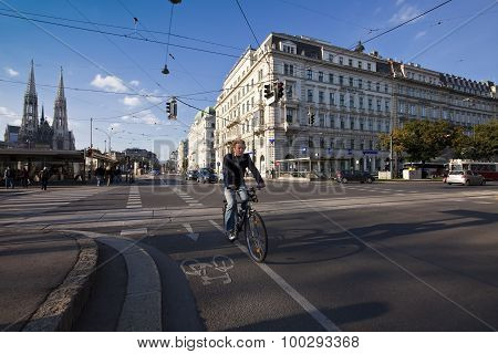 Urban Scene At A Crossing In The City Of Vienna With People Cars And Bicycle