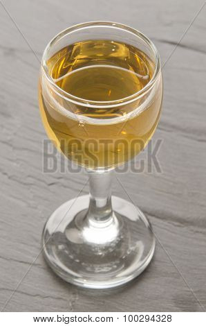 Calvados In A Glass On Grey Slate