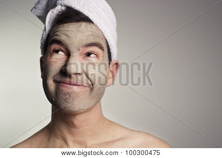 Man With A Mud Mask On This Face