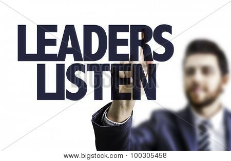 Business man pointing the text: Leaders Listen