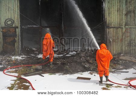 Russian Emergency Control Fire Drill In Orange Protective Suits Extinguishing Fire