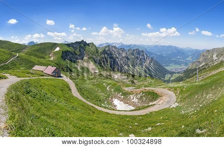 Mountain landscape with hiking trail and hut