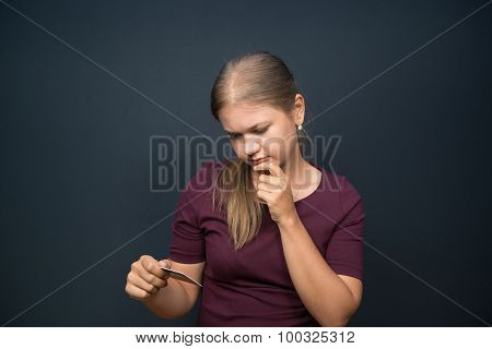 Young Woman Holding Bank Card