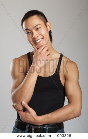 great looking asian guy shot in studio - martial arts pose poster
